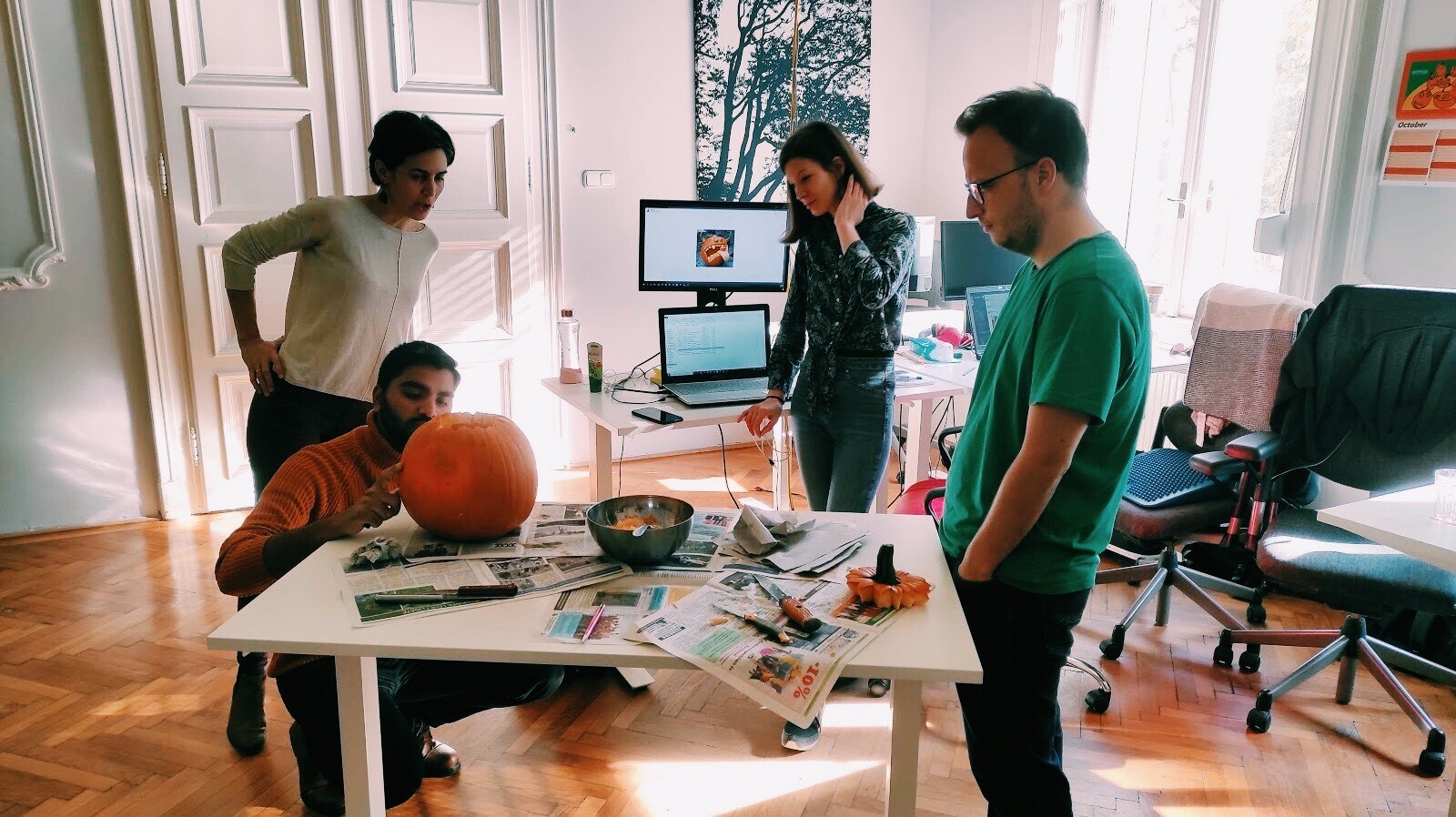 Our project management team carving their pumpkin