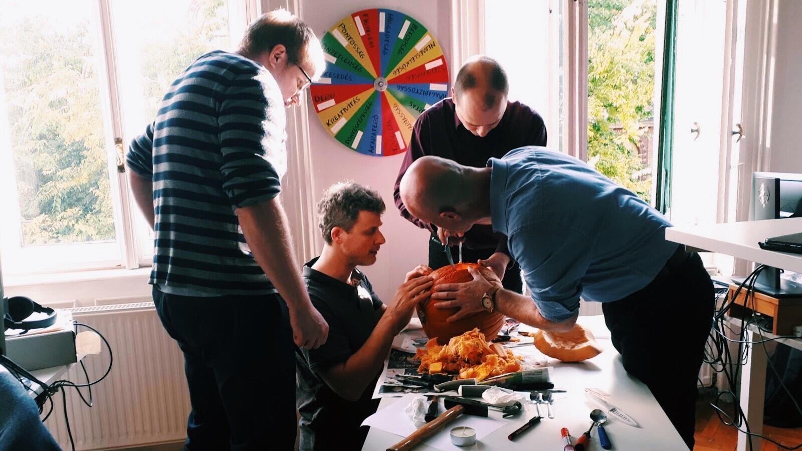 The engineering team carving their Halloween pumpkin