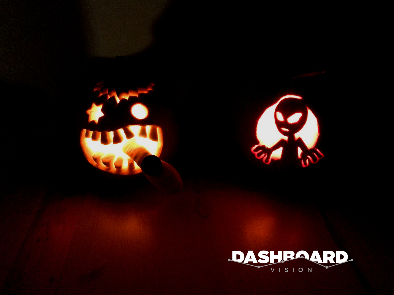Two pumpkins - the Alien and Cookie Monster from our annual pumpkin carving competition